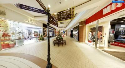 Дизайн системы навигации в интерьере подчёркивает дизайн-концепцию и бренд торгового центра